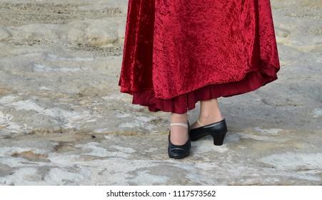 Photo of flamenco dancer. Legs fragment photo of spanish flamenco dancer.  Only legs cropped. Flamenco dancer dancing on the rock
