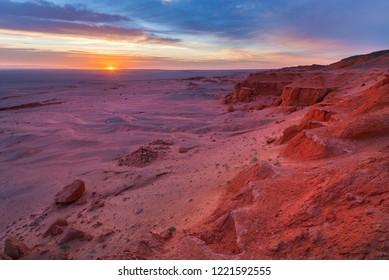 Photo of the Flaming cliffs in Mongolia, found in the Gobi Desert region taken during dawn