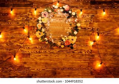 photo of flower wreath among light bulbs