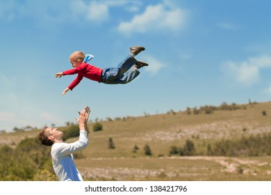 Photo of flying baby and father on sky background