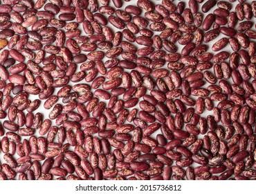 Photo food legumes pinto beans red motley groats. Texture background grain legumes pinto beans red motley groats