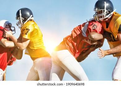 Photo of Football Players Tackling