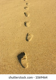 A photo of footprints in the sand