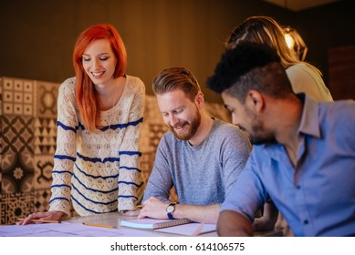 Photo of four business people working on a new project.
