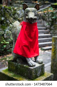 "Photo of a FOX STATUE aka. ""KITSUNE"" made of stone at a famous INARI SHRINE near KYOTO, JAPAN with a SHALLOW DEPTH OF FIELD."