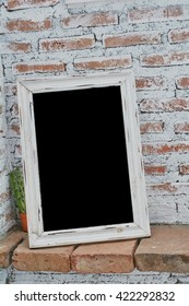 Photo frame with brick white wall ,copy space.