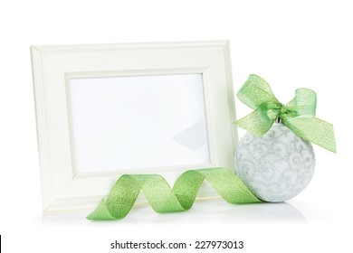 Photo frame and christmas decor with ribbon. Isolated on white background