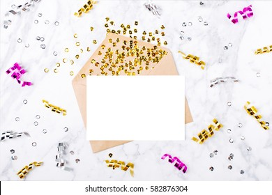 Photo frame or gift card with golden serpentines. Mockup template. View from above
