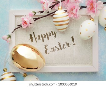 photo frame with greeting card. colorful easter eggs and spring flowers