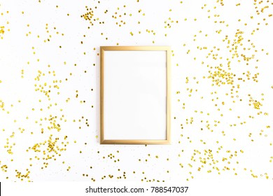 Photo frame mock up with space for text, golden confetti on white background. Lay Flat, top view. Valentine's minimal background.