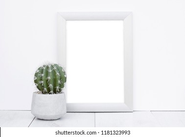 Photo frame mock up white wall background wooden grey floor with natural cactus in concrete flower pot