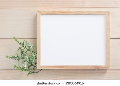 Photo frame mockup on wooden background.