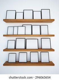 Photo frame on the white wall and wood shelf