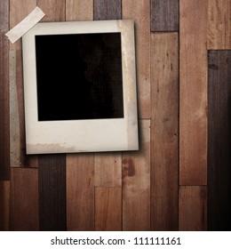 photo frame on wood background.