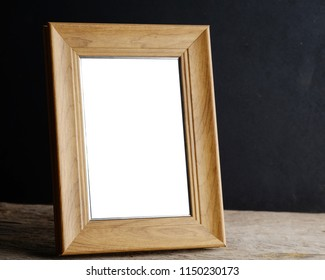 Photo frame on the wooden table .with copy space.