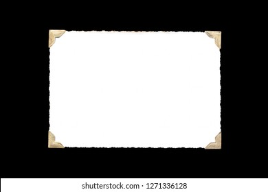 Photo frame - real old photo with white blank space for copy photo with gold coloured photo holder corners isolated on black background