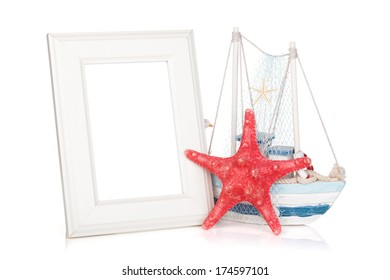 Photo frame, starfish and decor boat. Isolated on background