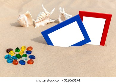 photo frames on sand,It's time to update your vacation photos,Shells, colored stones and photo frames, all of them are a reminder about a  vacation,photo frame on the beach,beach vacation,