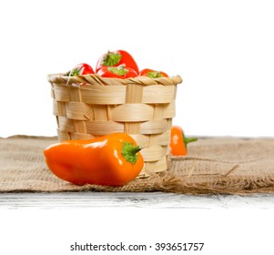 Photo of fresh pepper in a basket of burlap with white space