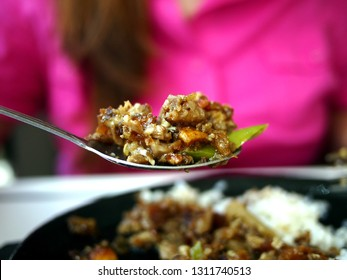 Photo of freshly cooked Filipino dish called Sisig on a spoon