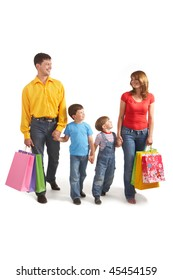 Photo of friendly parents and siblings with bags walking after shopping