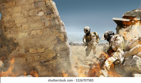 Photo of a fully equipped desert soldiers with rifle taking cover in stone trench with tactical armor and cracked damaged wall with fire and war tank background.