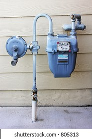 A photo of a gas meter attached to a house