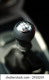 Photo of gear stick of modern sportive car
