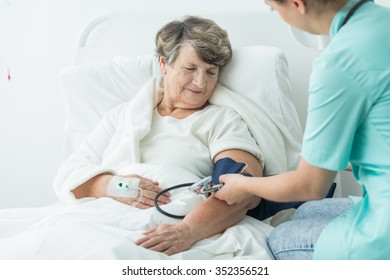 Photo of geriatric ward patient with hypertension and nurse