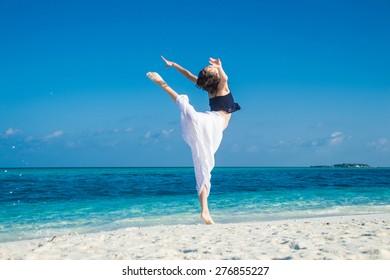 photo of girl dance at tropical beach