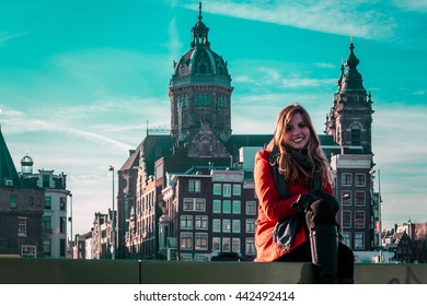 Photo of Girl in front of a church in Amsterdam, Netherlands