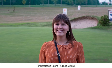 Photo of a girl on a golf course