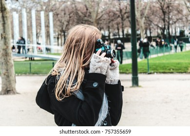Photo of Girl Taking Pictures of Eiffel Tower in Paris, France