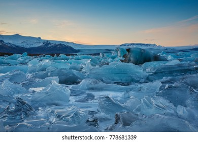 Photo of the Glacier Lake at sunset with the ice floating