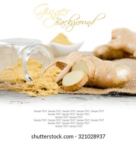 Photo of glass spicebox and wooden spoon with ginger powder and root on burlap and white blackground