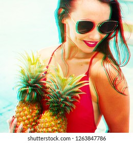 Photo with glitch effect. Young bright brunette girl have fun with two pineapple in her hands. Vacation and rest in tropical Thailand. Exotic beauty. Poolside party