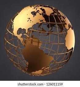 A photo of a gold globe on a dark grey background.