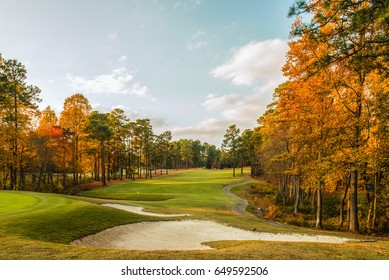 Photo of a golf course in North Carolina in the fall when the leaves have turned a brilliant orange color