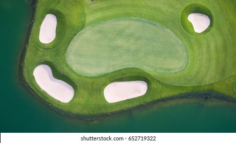 Photo of a Golf Green Flag and Hole from top by drone