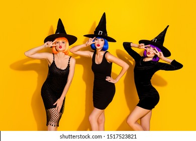 Photo of good kind life style cheerful positive nice glad beautiful pretty attractive ladies making v-signs near eyes sending air kisses to you wearing colorful wigs cap isolated shine background