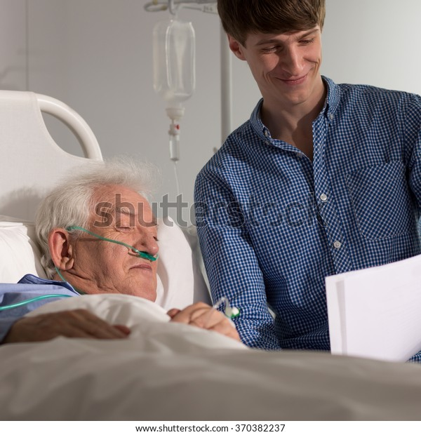 Photo of grandson visiting grandpa in hospice