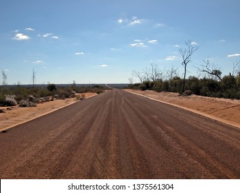 Photo of a gravel road that disappears into the distance, visual distance is 15 kilometers.          The long road, No Fuel for Six Hundred Kilometers, No People for Five Hundred Kilometers.