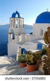Photo of Greek Church in Oia with sea background, Santorini Island, Greece