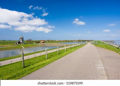 photo of green dike in wide open landscape