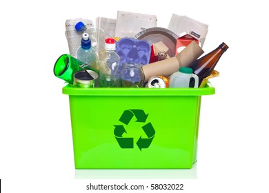 Photo of a green recycling bin full of recyclable items isolated on a white background.