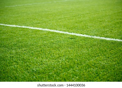 Photo of green soccer field with white stripe,