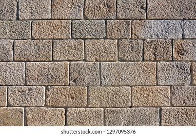 Photo of the grey brick wall