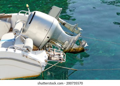 Photo of a grey motorboat engine in the sea