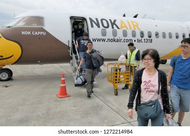 Photo of Group of passengers took a photo in front of Nok Air ATR plane background  Nan, Thailand December 22, 2018