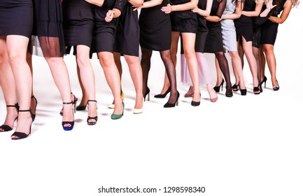 photo of a group of women in black dresses and shoes